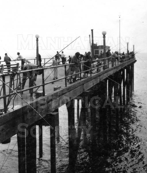 Fishing from the Wooden Pier Fishing Extension.  The extension was 200 foot long. It was built in 1927/28 and destroyed by the 1940/41 storms.