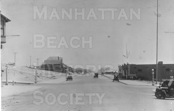 Looking south down Manhattan Ave. from Center St. (Manhattan Beach Blvd).  Arrow points to the new building that housed a notions store and a market which housed the second Post Office.