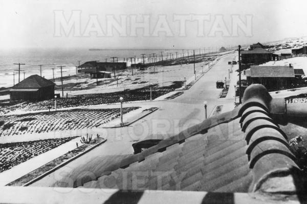 Manhattan Ave. looking north from the roof deck of the old Manhattan Hotel at 200 Marine Blvd.  Note Peck's Pavilion, pilings of the ruined Peck's Pier, and the Standard Oil Wharf in the background.