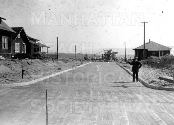 Early resident Fred Young points out the paving of Highland Ave. south of 13th St.  The streets to the west of Highland were completed prior to World War I.