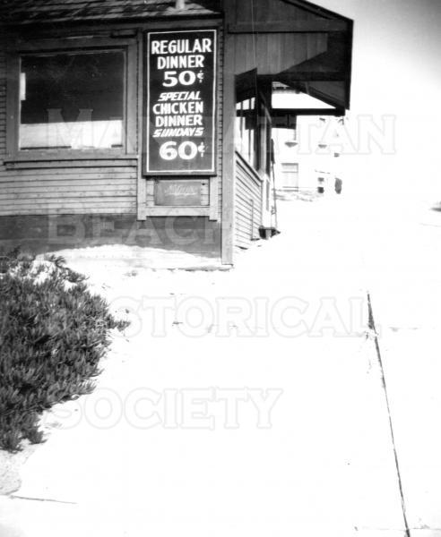 Ole's Cafe.  Oscar and Grace Olsson operated this Cafe during the early 1930s 125 Center St. (M.B. Blvd.).  The Cafe was later bought by  XXX and called the Green Shack Cafe.  The building was first used as John Merrill's office and then as the rented first City Hall from 1912-1914.    Note the price of a complete dinner.