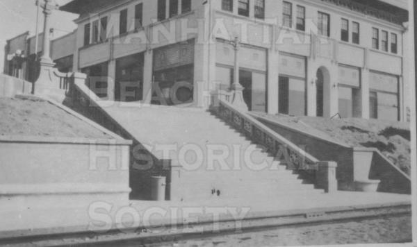 The Sadler Building on a triple lot at 2120 The Strand.  The city rented the top floor for the second city hall from 1914 to 1916.  The steps at the foot of Marine Ave. still exist.