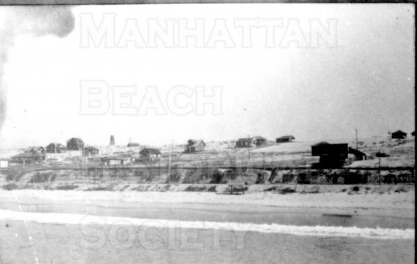 The Strand with Manhattan Beach in the background, looking northeast from the Old Iron Pier.  On the extreme right is theBeach Store  which stood at 12th St. and The Strand.
