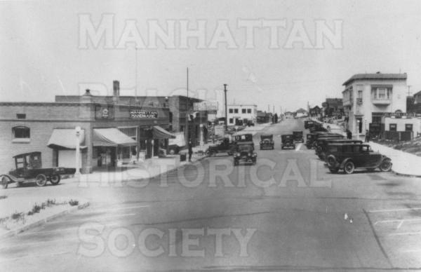 Looking northwest up Manhattan Ave. from 10th Pl.  Note the Manhattan Hardware delivery truck at the left: it was used by the volunteer fire department to take their reel and hoses to fires.