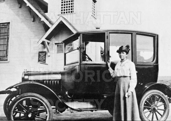 Miss Alise Jacobs, superintendent of the Community Church Sunday school.  Her Ford Model-T and the church (at 904 Highland Ave.) are behind her.