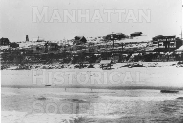 "Looking north from the ""Old Iron Pier,"" showing the board walk and the Beach Store at 12th and the Strand.  The streets are still unpaved.  ."