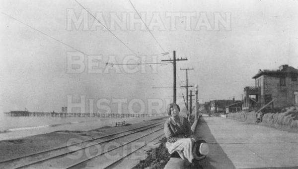 "Miss Campbell (Dr. Campbell's daughter) with the ""Old Iron Pier"" and the Pacific Electric railway tracks in the background. ."