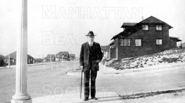 Dr. Campbell, minister of the Community Church at 904 Highland Avenue. Looking north on Manhattan Ave from 10th Street .