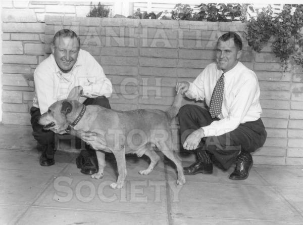 Old George with Hugh Reynolds and John Campbell in front of the downtown post office at 1142 Manhattan Ave.  The day he received a complimetary dog tag.