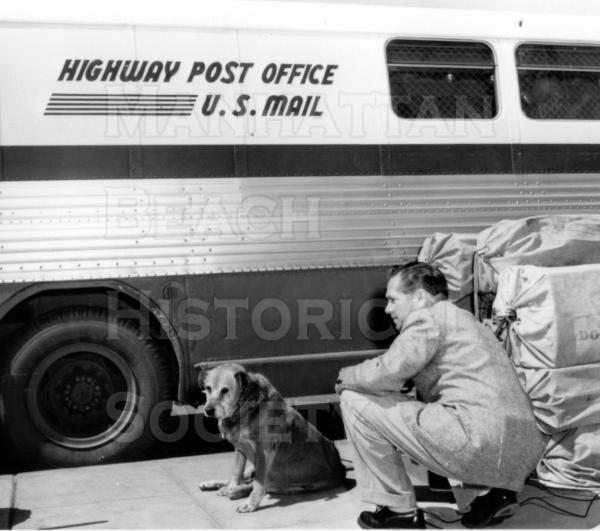 Old George with John Campbell in front of a Highway Post Office bus in front of the the downtown post office at 1142 Manhattan Ave.