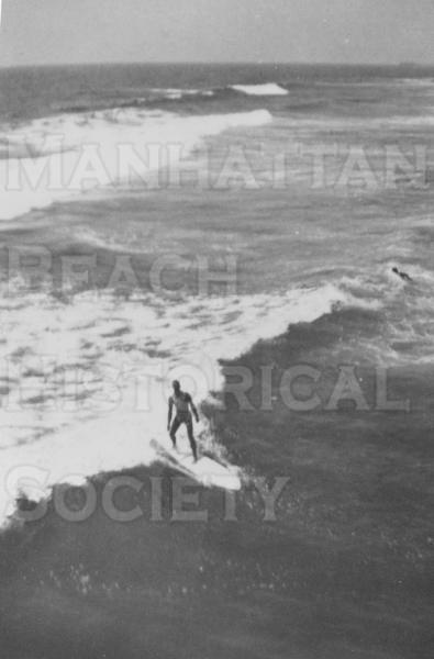John Dale surfing.  He was one of the first surfers in the South Bay.