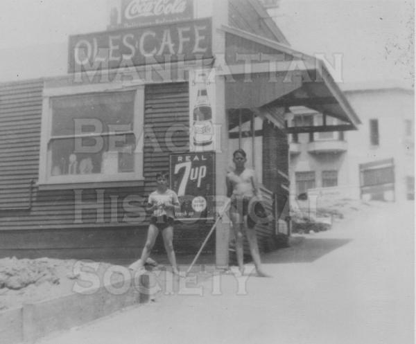 Ole's Cafe.  Oscar and Grace Olsson operated this Cafe during the early 1930s 125 Center St. (M.B. Blvd.).  The Cafe was later bought by  XXX and called the Green Shack Cafe.  The building was first used as John Merrill's office and then as the rented first City Hall from 1912-1914.  Circa late-1930s. .