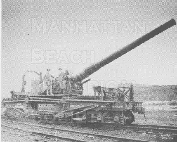 An 8-inch railway gun used for coastal defense.  A gun of this type was placed in Manhattan Beach during the war.  Battery E came here from Fort MacArthur in San Pedro and the men were quartered in the same buiding (516 8th St.) that is used for the present day Badmidton clubhouse.  The gun was placed on tracks that were east of the Santa Fe track along the present day Veterans Park/greenbelt.