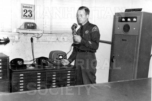 Manhattan Beach police dispatcher in the city hall.
