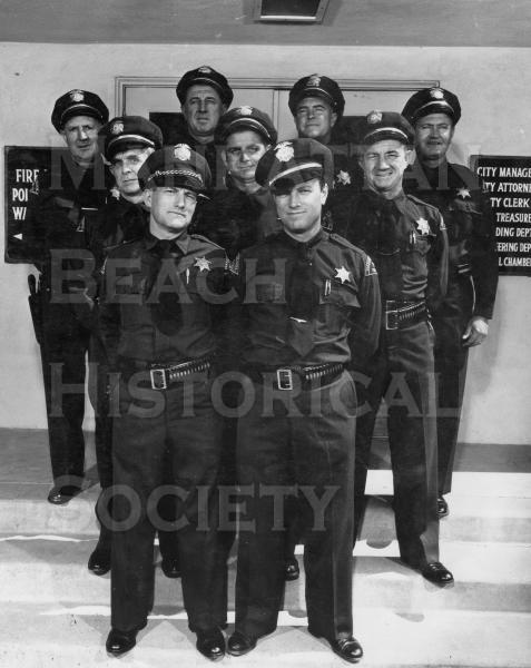 Manhattan Beach police officers.  Note the sign on the left.  The fire and police departments were located in the city hall.