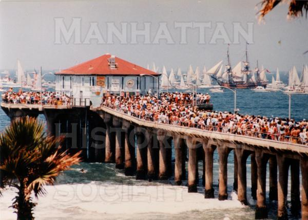 "The Manhattan Beach Pier and the ""Tall Ships Parade,""  This was a kickoff for the Olympic Arts Festival as part of the Summer Olympics in Los Angeles."