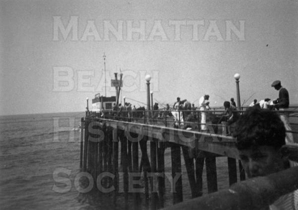 The wooden fishing extension completed in 1928 extended the pier length by 200 feet. It allowed fishing off the Pier and provided for a water taxi to and from the fishing barge, Georgina.  It was destroyed by a severe winter storm in 1940/41.