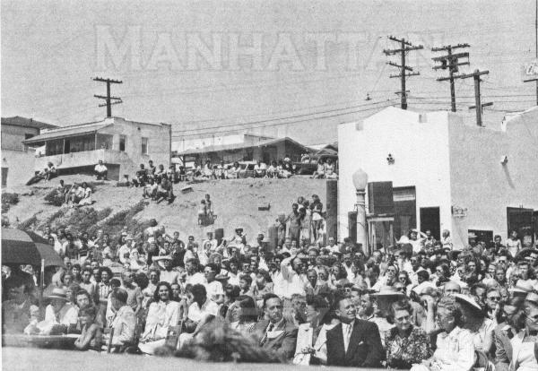 Looking in the NE direction from the base of the Pier. The closest building is the White Stop hamburger stand at 101 Manhattan Beach Blvd.  The crowd is for the fishing derby and beauty contest on June 21, 1948.