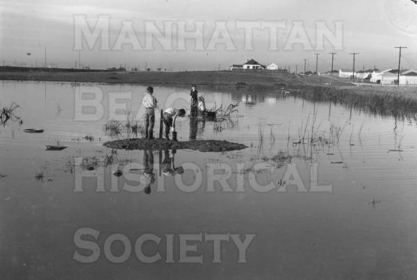 Flooded field near the south-east corner of present-day Polliwog Park.  Note Redondo Ave. and Liberty Village in background.  Judge Benjamin F. Brown's ranch house (at 1801 Redondo Ave.) is where the present Manhattan Beach Middle School is located.