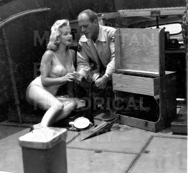 Actress Greta Thyssen (Miss Denmark of 1951) and a L.A. Co. lifeguard, on the Bay Watch boat.  Publicity shot.  .