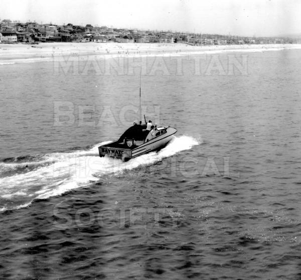 The L.A. Co. Lifeguard boat Bay Watch accelerates south of the Pier.  Publicity shot.