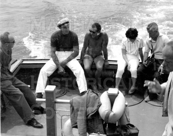 Actor Jock Mahoney (Sally Field's stepfather) on the L.A. Co. lifeguard boat Bay Watch with Ted Davis and others waiting for the paddleboarders to come in.  Publicity shot.