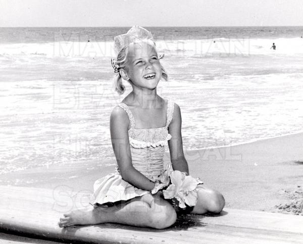 Six-year-old Robin Curtis was Miss Paddleboard for the 1960 International Paddleboard Classic. This annual paddleboard race is still being held.  The race is from the Ismus of Catalina Island to the Manhattan beach Pier.