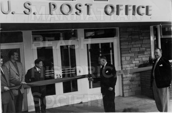 "The Post Office at 1142 Manhattan Ave., the location of the Manhattan Beach Post restaurant.  Note the Air Force poster (during the Korean War) and the Highway Post Office"" bus""."