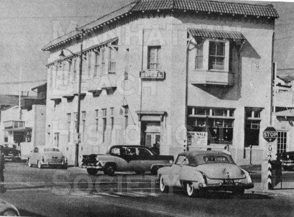 This was the first two-story building in Manhattan Beach (built in 1902).  It initially contained a hotel, grocery store, and Post Office.  Located at 201 Manhattan Beach Blvd., it later contained a bank and was demolished in 1965.  It was replaced by the American Savings (presently Chase Bank) Bldg.