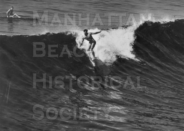 Tulie Clark surfing in Hermosa Beach.  From Life Magazine.