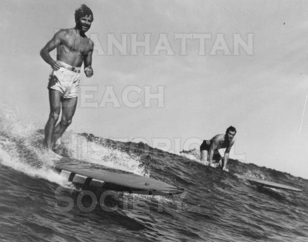 Life Magazine.  The standing surfer is Tom Blake, inventer of the surfboard fin, chambered surfboard, and various life saving gear.