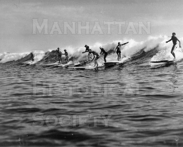 Four board surfers and two body surfers at San Onofre.  From Life Magazine.