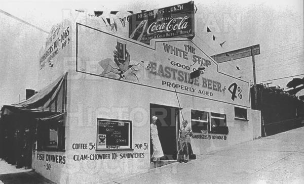 The White Stop Cafe was at 101 Center St. (now Manhattan Beach Blvd.).  Shown are the owners: Al and Mildred Switzer.  Note that complete dinners cost only $0.50.  The White Stop was operated from the mid-1930s to the early-1960s.