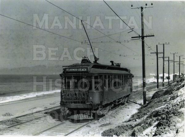 "Last Pacific Electric ""Red Car"" on its way north of Manhattan Beach.  Playa del Rey is in the background.  The P.E. Redondo Beach line was taken out of service in 1940 for lack of ridership."