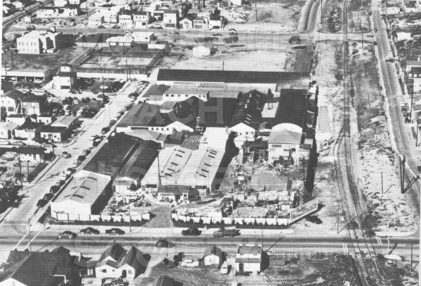 Aerial view of the Metlox Pottery facility.  Note the Santa Fe railroad spur line for Metlox.  Also note that the future Valley Blvd. is blocked by the metlox property and Kuhn Bros. lumber yard property from 10th St. to 14th St.  The rail spur line caused Valley Blvd. (then called E. Railroad Dr.) to be blocked from 15th to 10th St. until it was opened in the early 1960s.